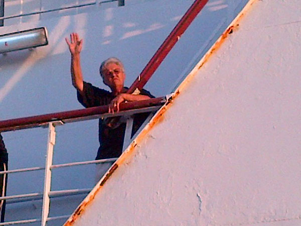 Janet waving from the ferry