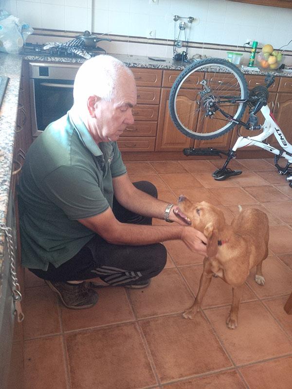 Rudi enjoys neck scritches from Bob