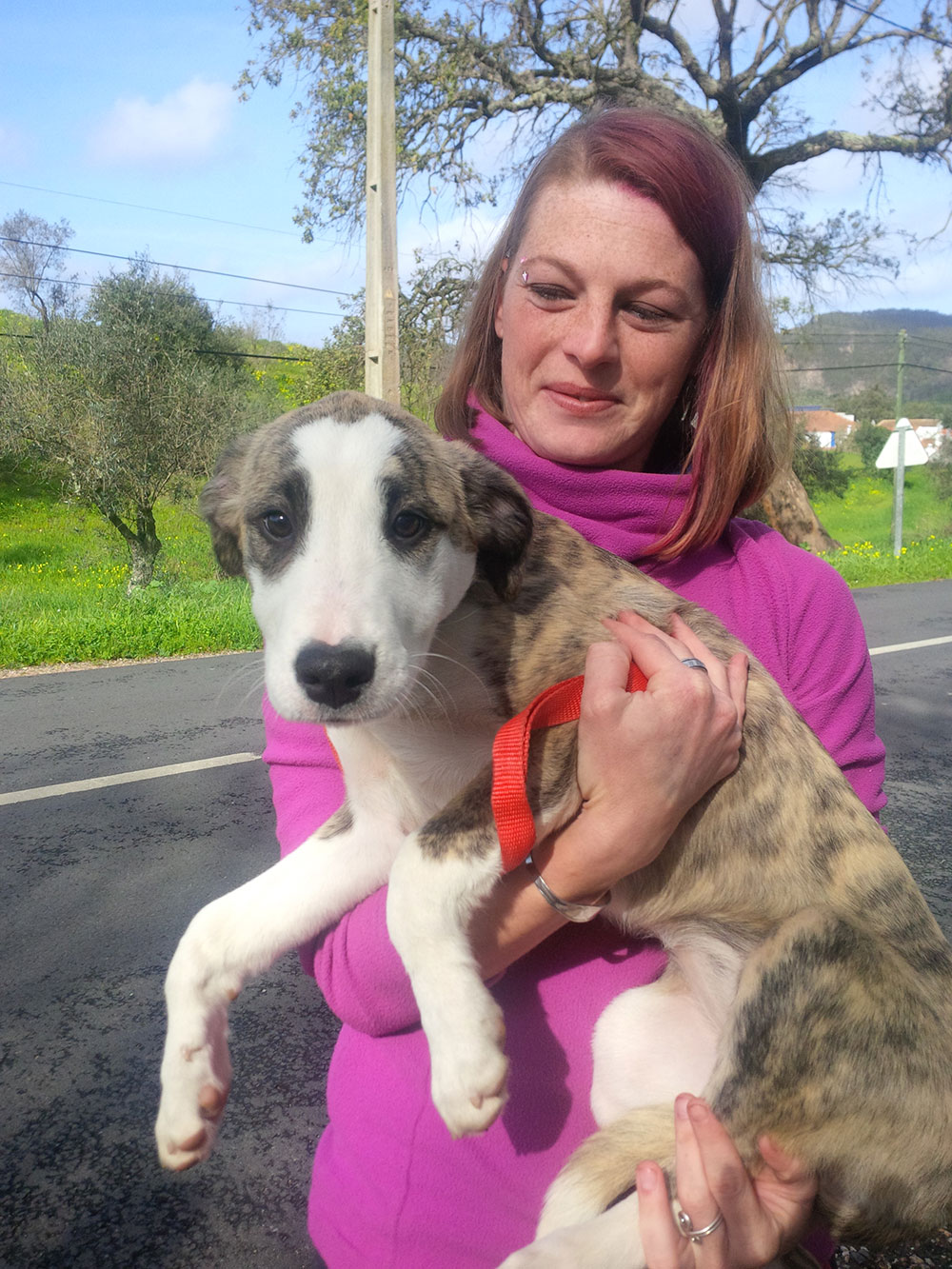 Emma holding Jecca — what a gangly puppy!