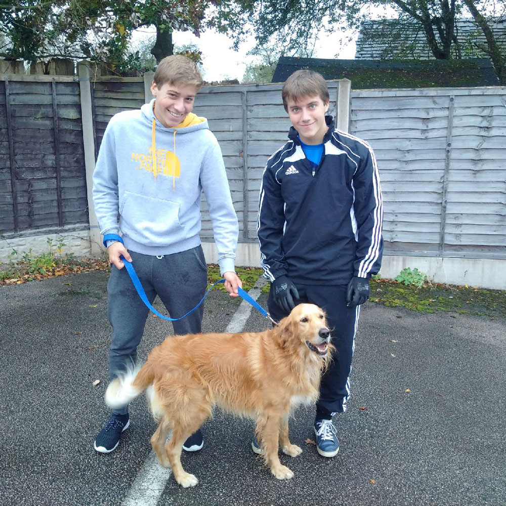 Alfie with Deven and Tylor, members of his wonderful new family