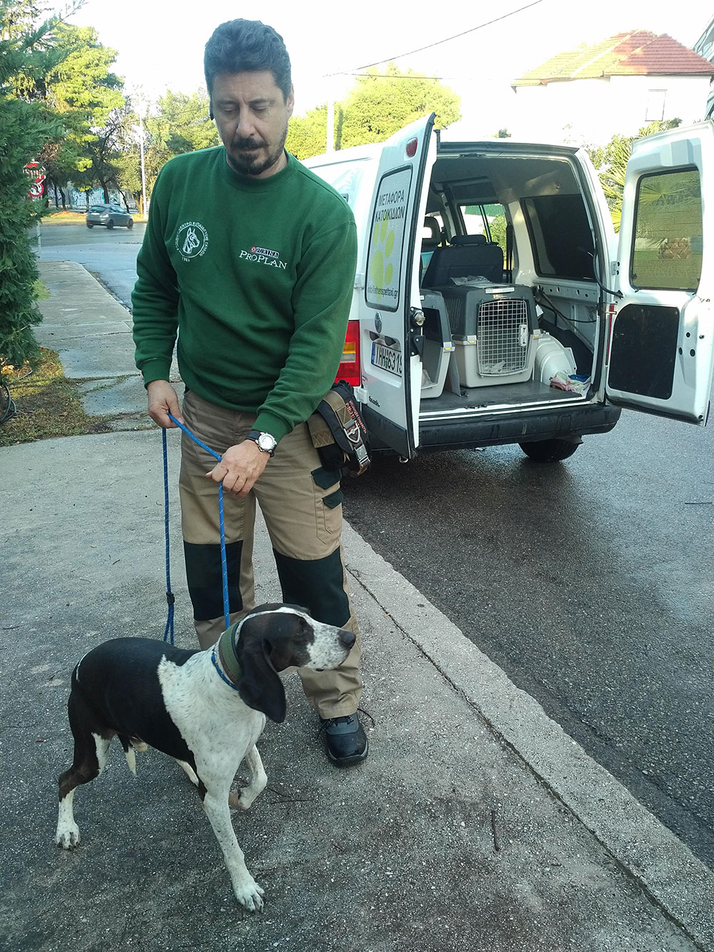 Our friendly, helpful pet taxi driver Akis, with Wilson