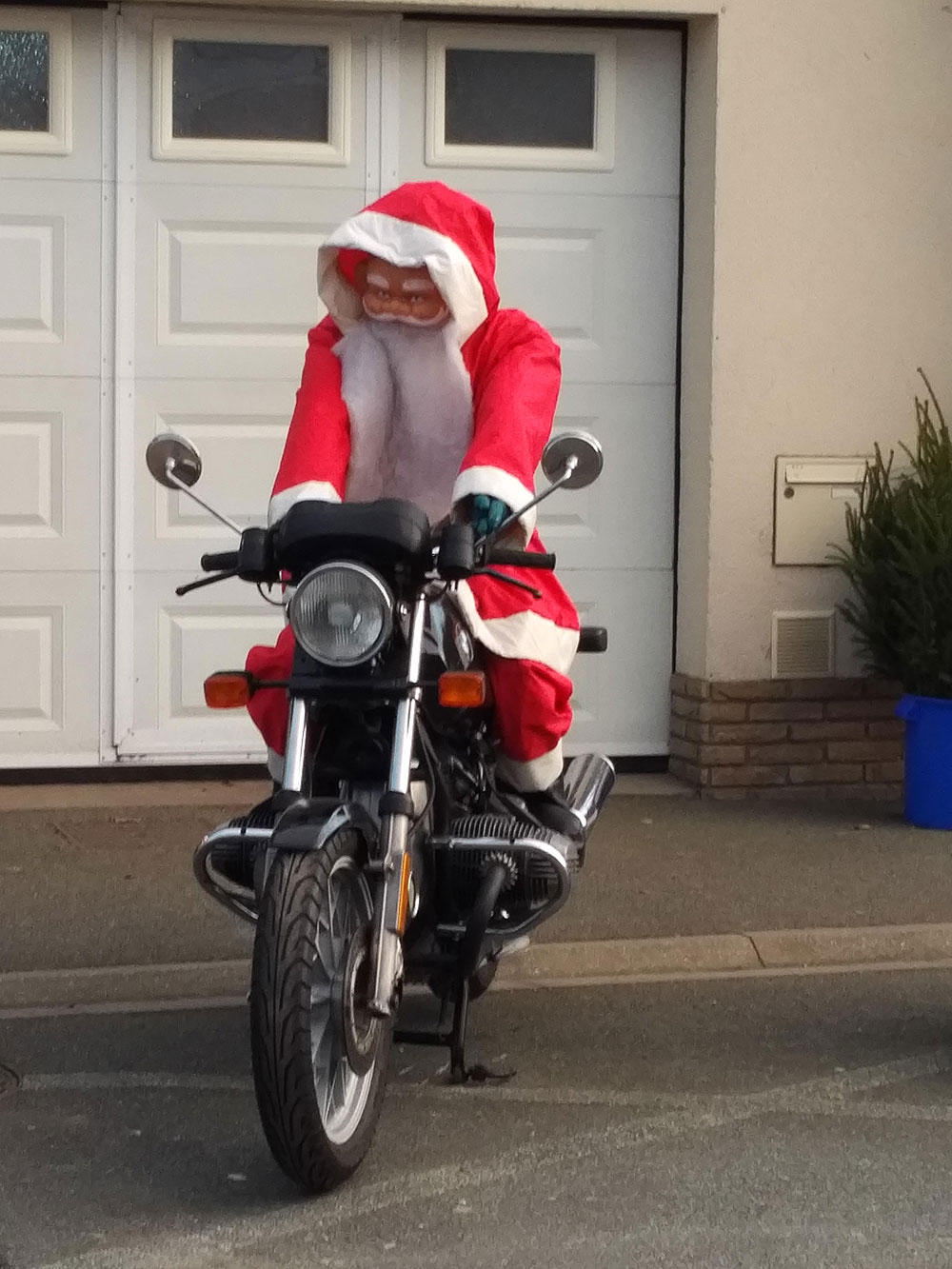 Father Christmas in Calais, dispensing with Rudolph and opting for a faster mode of transport to reach everyone in time
