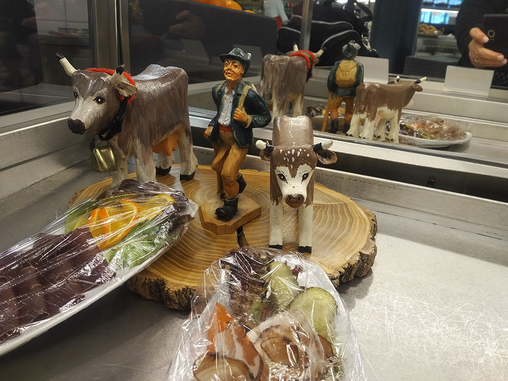 Fortunately, the Swiss have a special style of kitsch that's enough to cheer anyone up — as were the tempting morsels[ placed alongside these figurines!