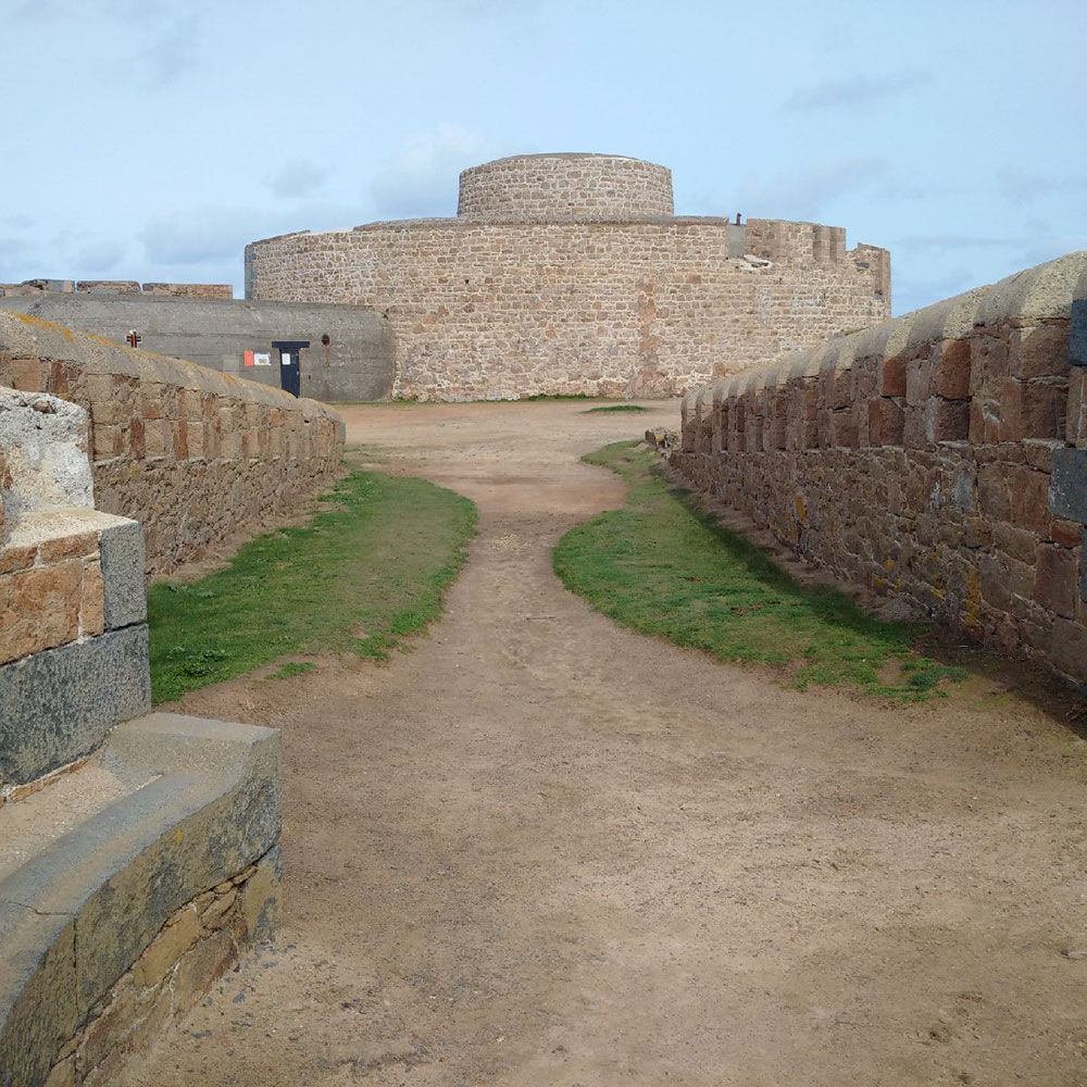 Fort Hommet on Vazon Bay headland, built on the site of fortifications dating back to 1680, with notable additions during the Victorian era and World War Two