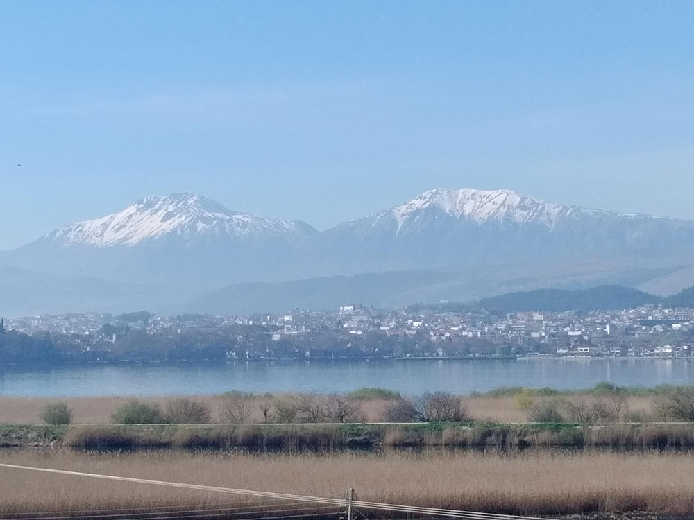 The view over the lake from our hotel room, with a backdrop of the town and snow-capped mountains beyond