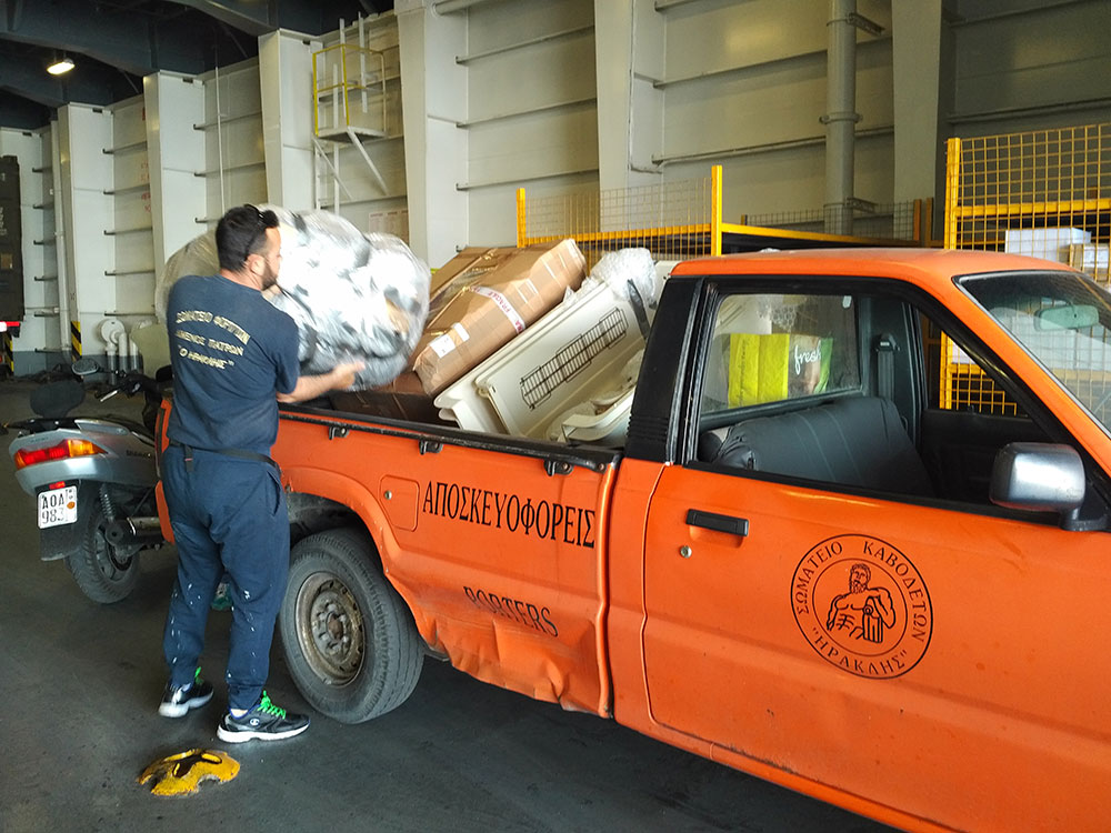 Another small truck was needed at Patras! Courier J received so much help, and at no charge. Thank you, port support staff at Patras!