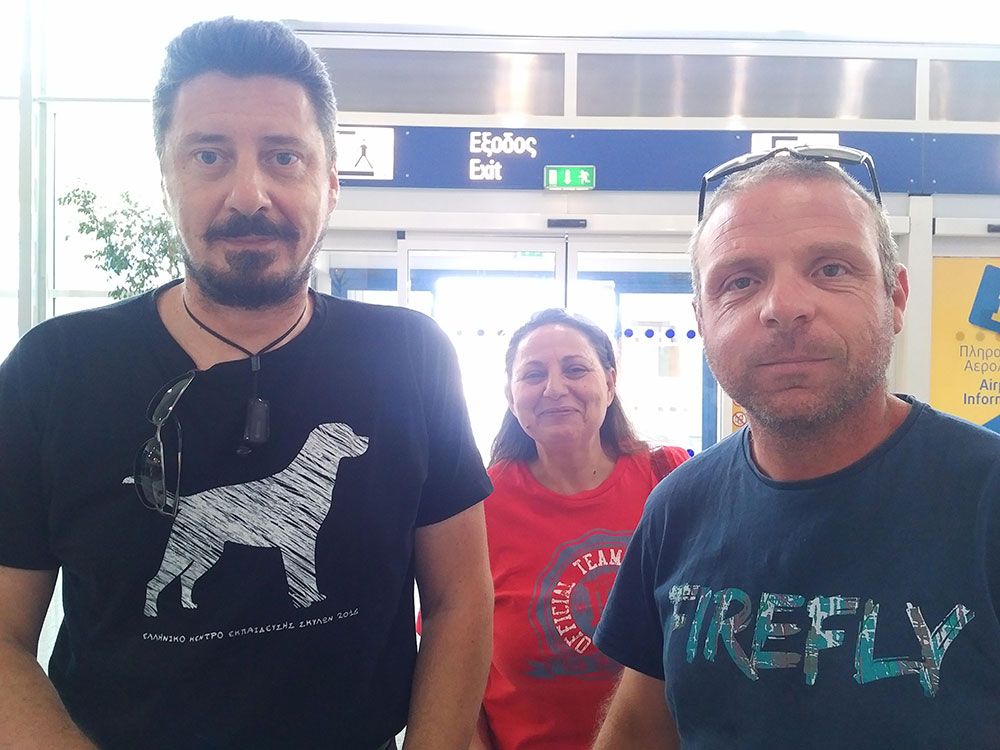Akis (L) with a colleague. Akis helps us every time we're in Greece, with his dependable pet taxi service.