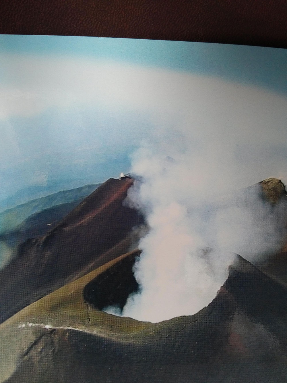 We didn't make it all the way to the top of Mount Etna, but this postcard shows what we might have seen if we had!