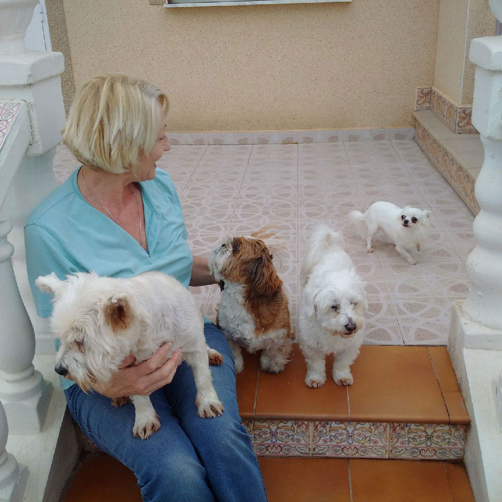 Annette with four of her dogs shortly before departure — Susie, Raffi, Lucky and Lily