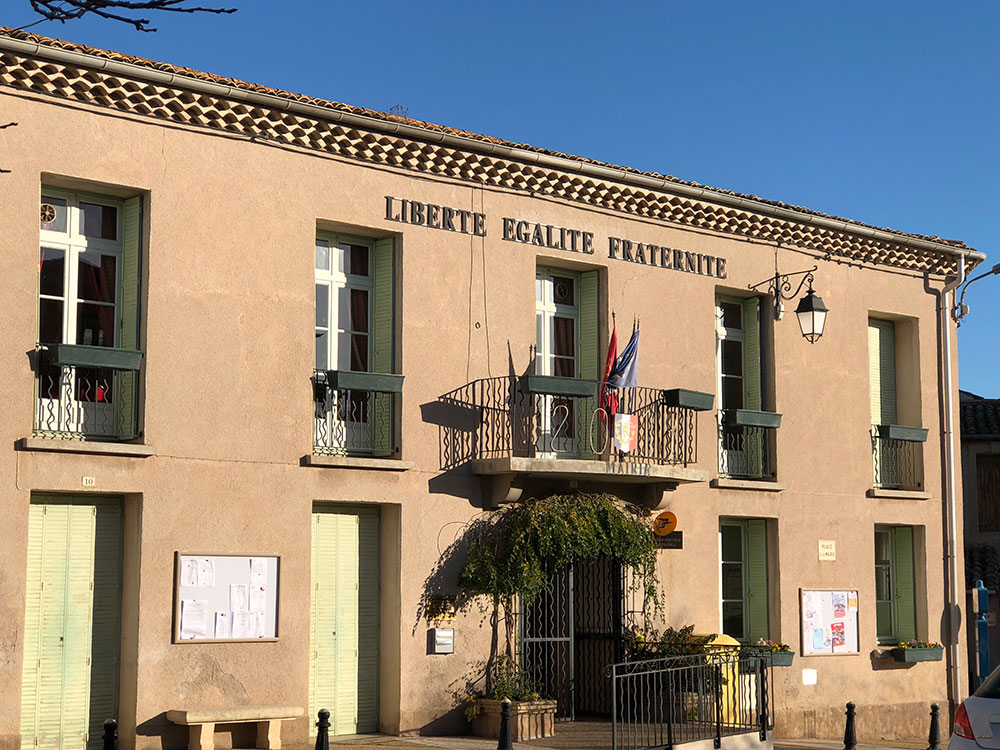 The mairie (town hall) sporting the tricolour and France's national motto