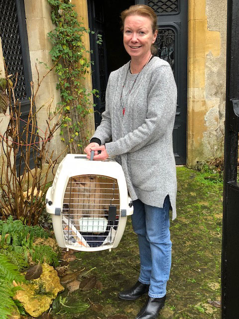 Delivering pets to their families - Linda welcoming Katie to her new home