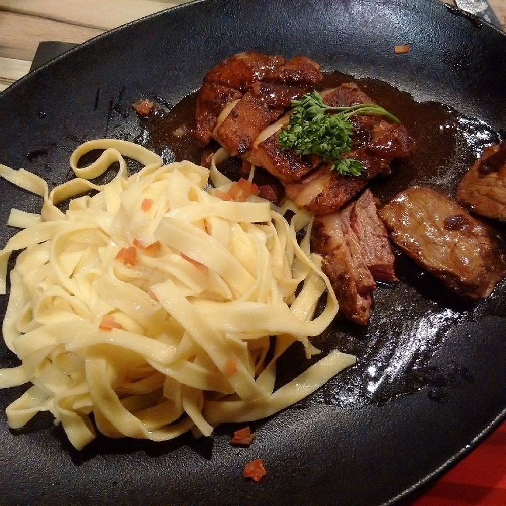Courier Richard's noms — duck breast with tagliatelle. Perfect!
