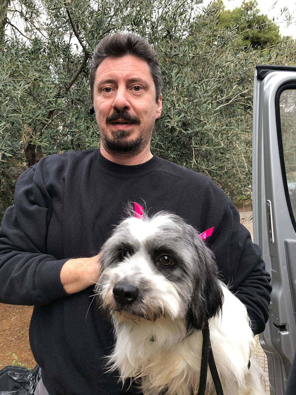 Beautiful Cleo — having a cuddle with Akis, our wonderful, dependable pet-taxi-driving friend in Athens