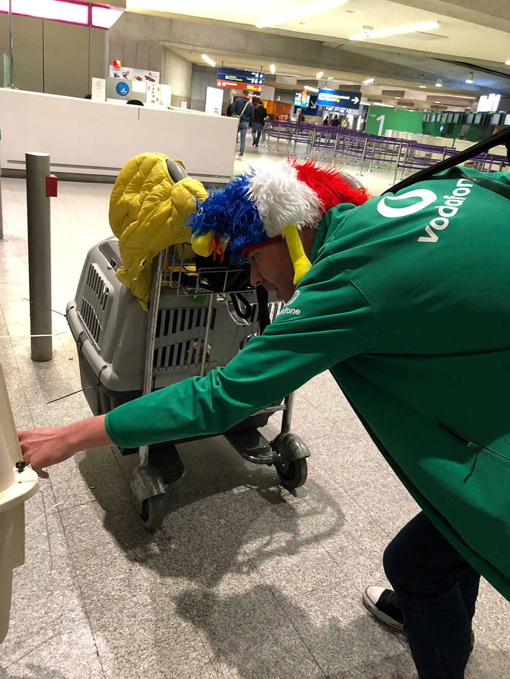 CDG was full of Irish sports fans travelling home after an international match in Paris. This friendly chap, sporting a fine piece of headwear, spent some time chatting gently to the dogs. He was happy to hear they had forever homes to go to.