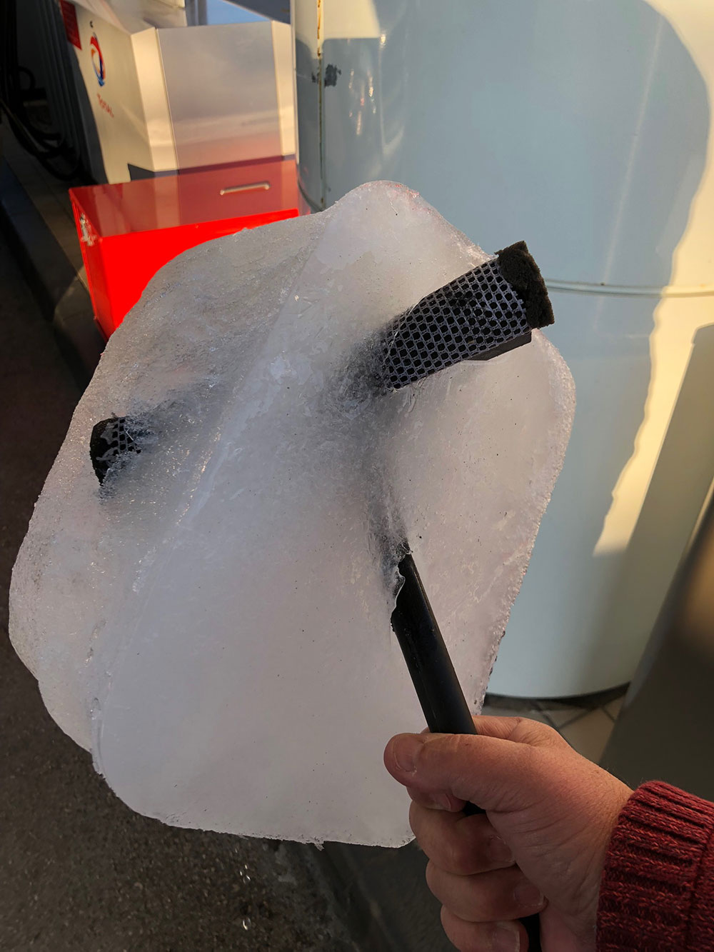 A sign of how cold it was in the middle of France — when we stopped for fuel, courier M noticed that the fuel station's ice scraper had turned into an ice lolly!
