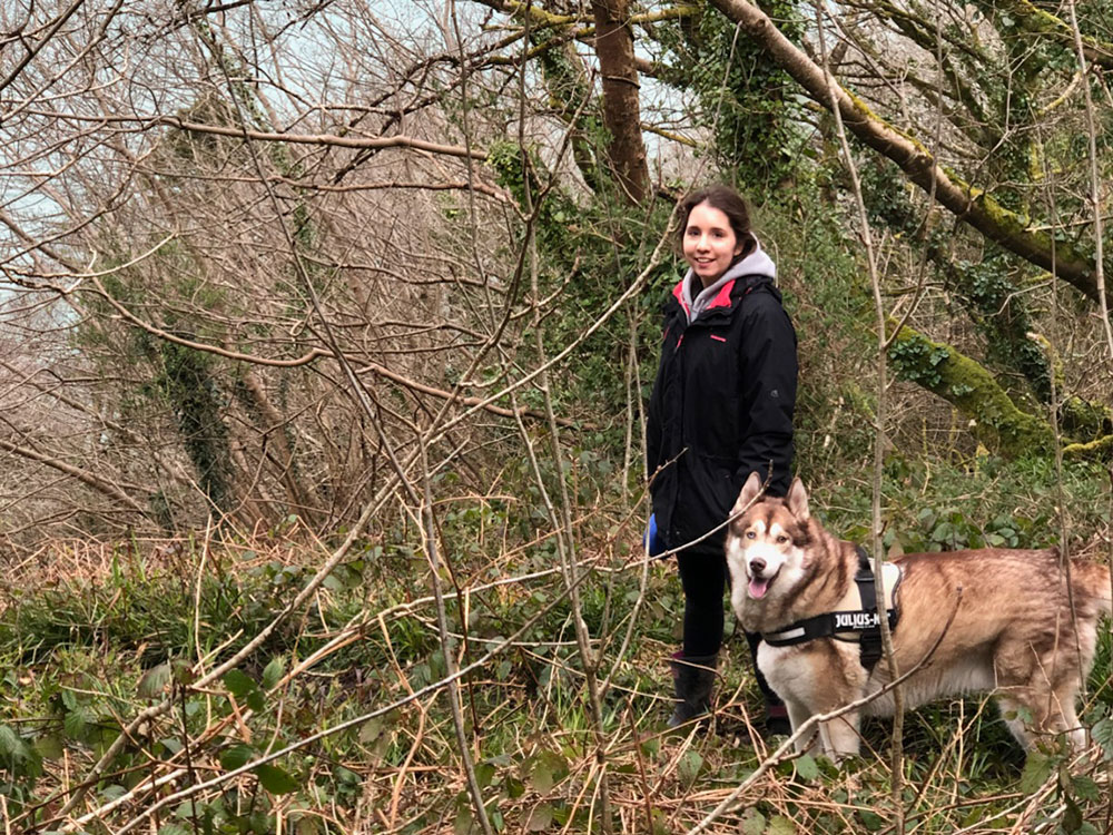 """Oskar at home in Ireland with Laura, who wrote to say: """"Oskar has happily settled in, and is really enjoying his garden and the woods. Thank you again for looking after Osky so well. We really appreciate how reassuring and kind you were. We felt sure he was safe in your hands!"""""""