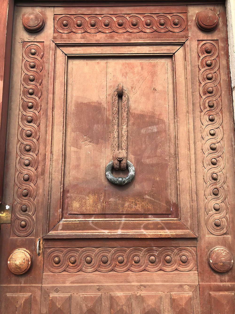 This ornately carved front door was keeping Kemet safe from the traffic