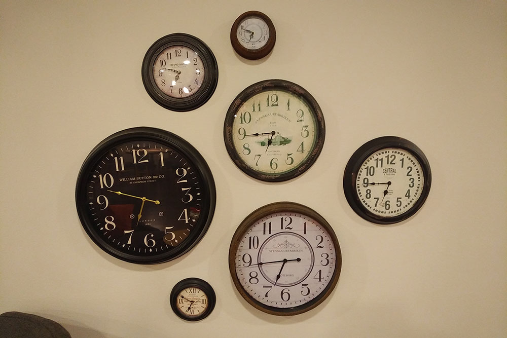 Seven dials — clocks at our hotel for the night, none straight, none telling the right time!