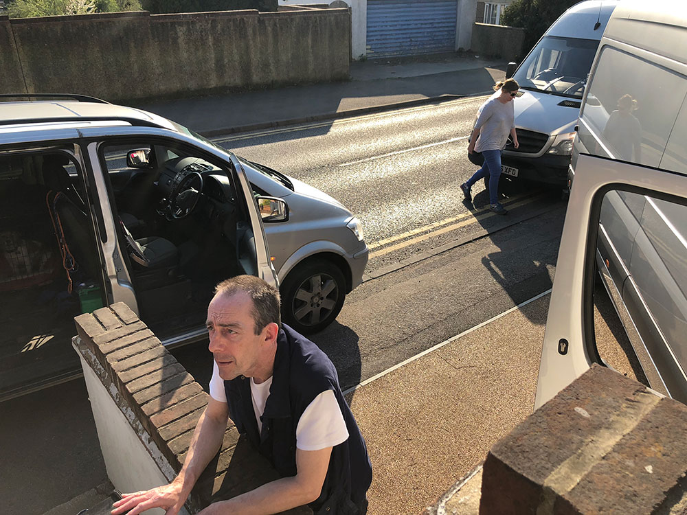 Courier Richard receives France-bound pets, including Bailey, from courier Helen