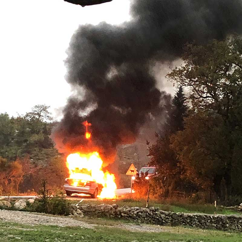 We've experienced many holdups on our journeys — strikes, ferry cancellations, bad weather — but never a car on fire before. We were less than a mile from the dog shelter and near the top of a mountain.