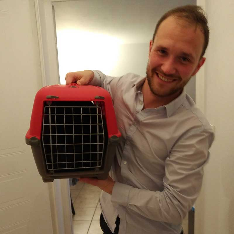 Alex looking relieved that Poupoune is safely inside the cat carrier at last!