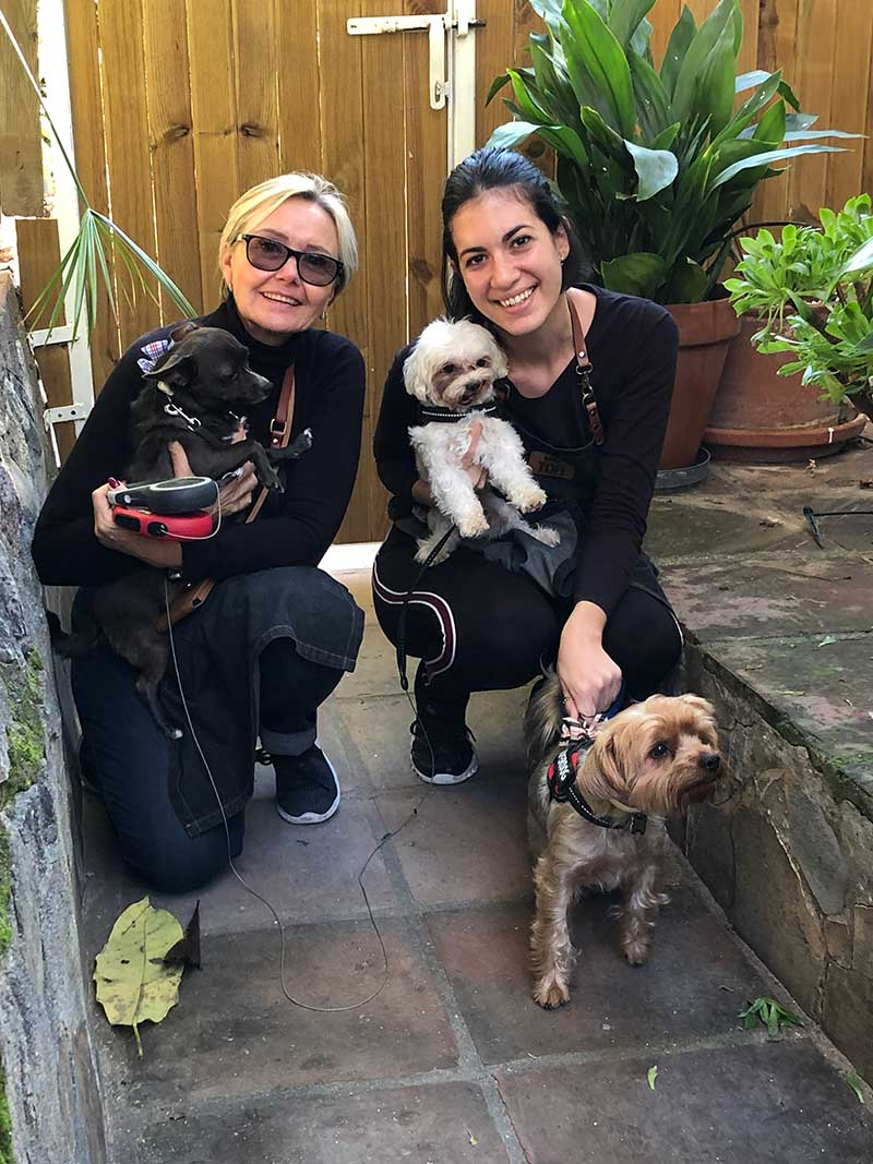 Hotel owner Antoinette and kennel manager Lucia with Rocky, Tyson and Arnie