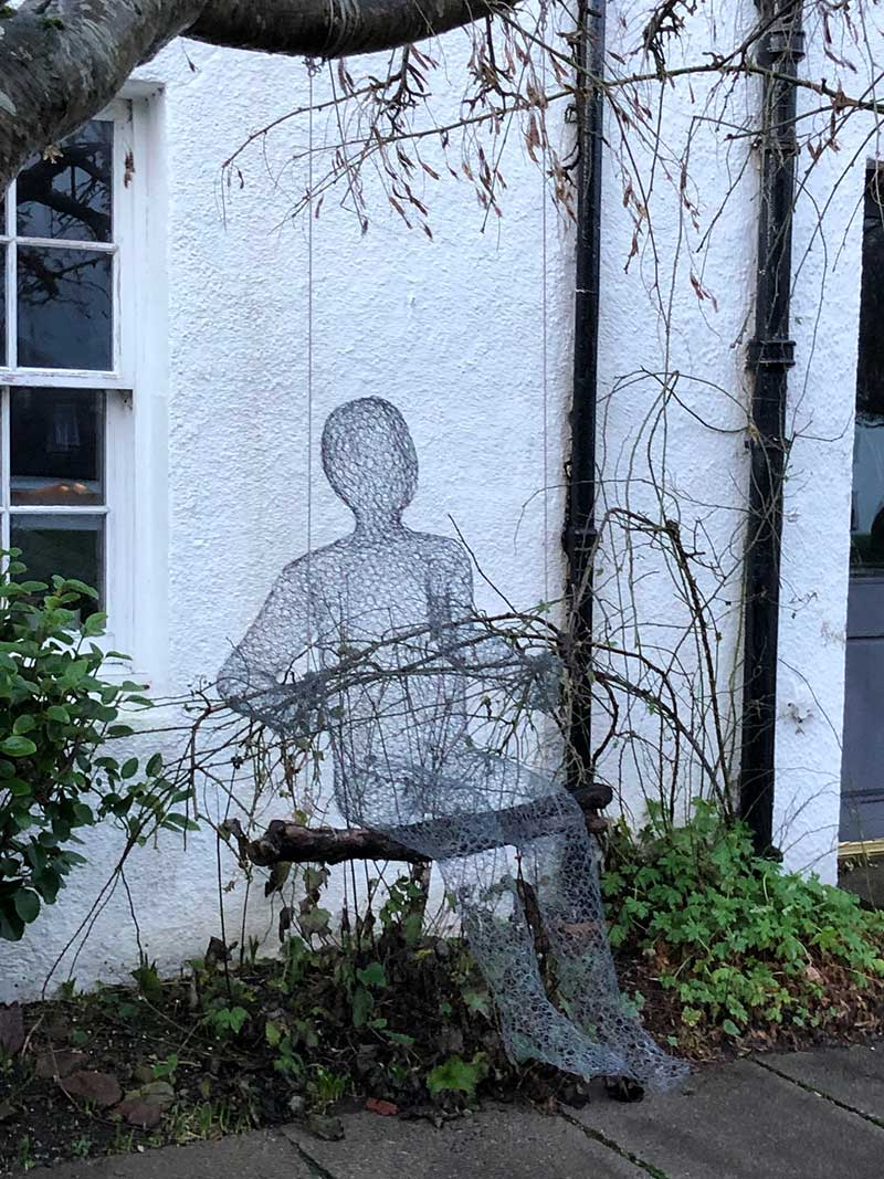 More creativity in Ullapool — this lifesize figure made of chicken wire was sitting comfortably on a swing