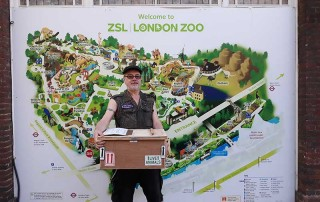This is Craig, who's responsible for invertebrates, arachnids and similar creatures at ZSL London Zoo, taking delivery of the shipment of snails. The crate was sealed for protection and temperature control.