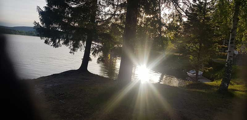 Sunlight on the lake at our Swedish lodge
