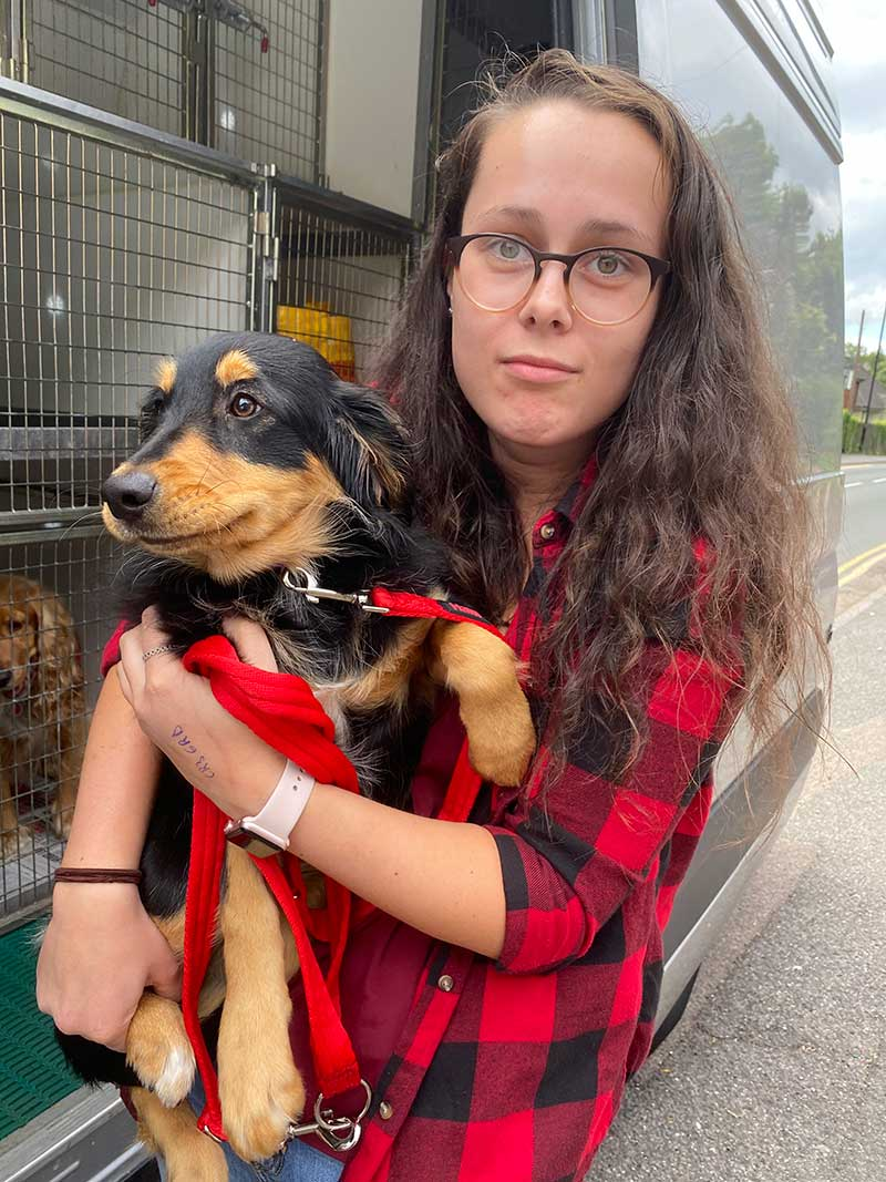 pet travel trips : We stopped off in Poitiers to collect Sarah's new pup from the breeder. Here's Sarah welcoming her little bundle of fun to the UK.