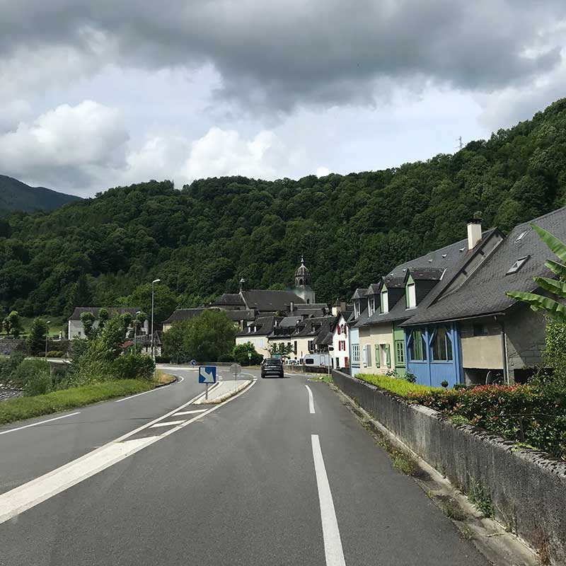 pet travel trips : Courier Ricardo enjoyed travelling through villages in the Pyrenees