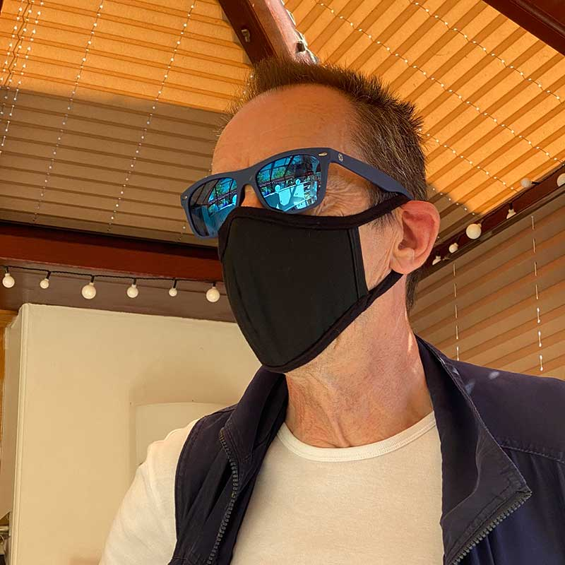 Like courier Richard here, all our couriers are taking health and safety precautions that include the wearing of face masks