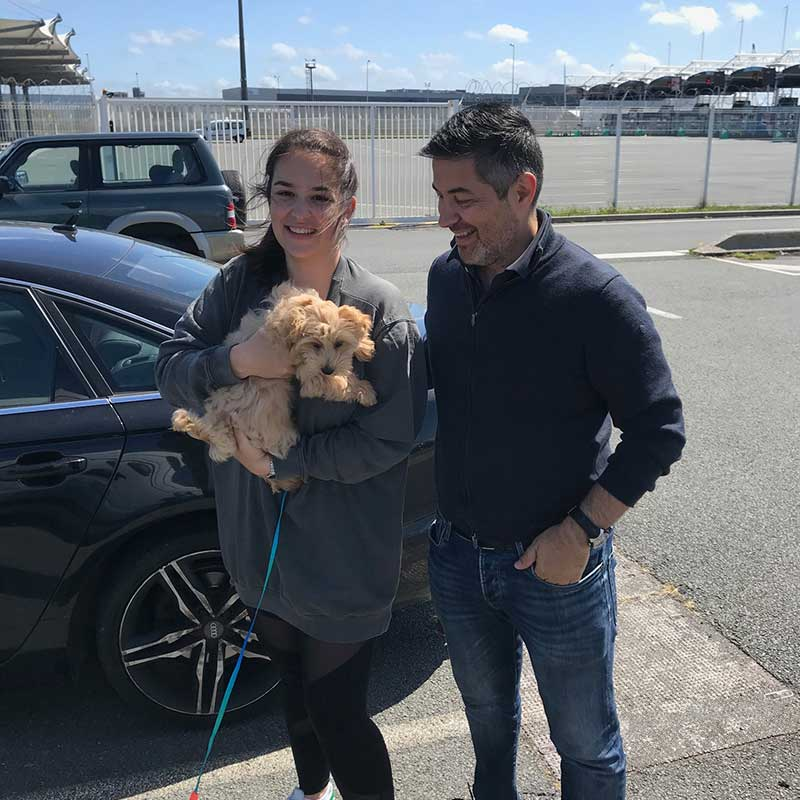 travelling in France : Aleksander and partner thrilled to receive their darling puppy at Calais