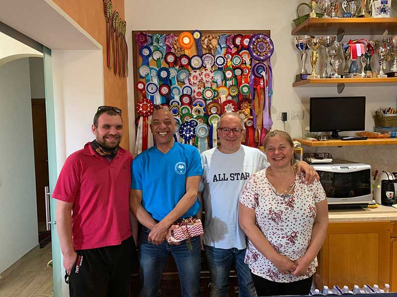 Left to right, couriers Ryan and Shane with Luigi and Gigi. And just look at all those rosettes and cups on the wall behind!