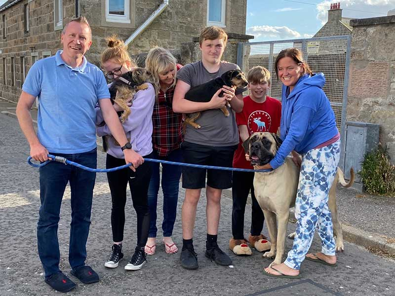 Tartan trips: Smiles all round as the family is reunited in Scotland