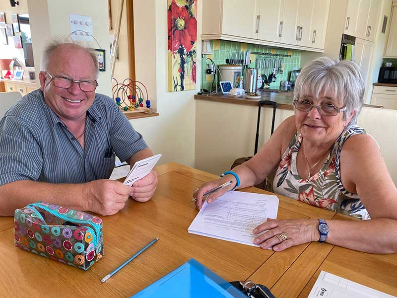 Kip and Sue looking excited as the signed the initial paperwork for their pets' journey